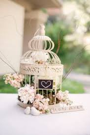 birdcage centerpieces baby s breath in a birdcage for the dinner table s centrepiece