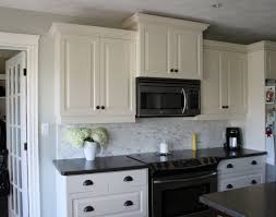kitchen kitchen backsplash white cabinets brown countertop sets