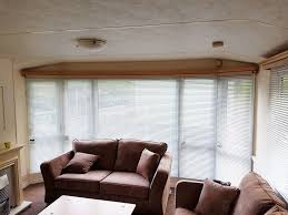 venetian blinds fitting in a living room mcbespokeblinds