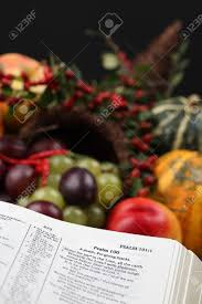 a psalm of thanksgiving bible open to psalm 100 with thanksgiving text and cornucopia