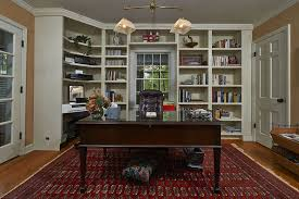 traditional home office with hardwood floors built in bookshelf