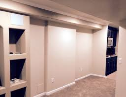decor attractive basement finishing with white accent wall design