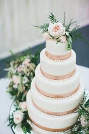 decorating a wedding cake with fresh flowers wedding cake layered