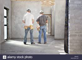 construction workers inside unfinished home stock photo royalty
