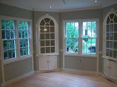 detailing at the top around the doors open windows similar