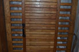 freight elevator gates of oak as room dividers sliding doors or