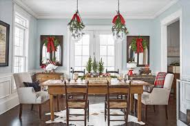 dining room with food christmas table settings decorations and