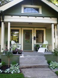 cottage porchgreen is the defining color on this porch using the