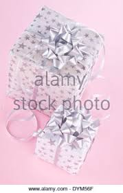 Beautifully Wrapped Gifts - beautifully wrapped christmas present on table stock photo
