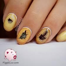 piggieluv freehand dinosaur eggs nail art