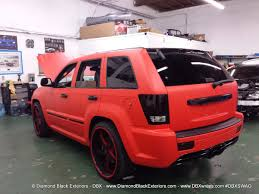 matte orange jeep jeep grand cherokee srt8 wrapped in matte red 3m by dbx diamond