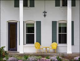Motel Chairs Yellow Motel Chairs On The Porch Of An Old Brick House