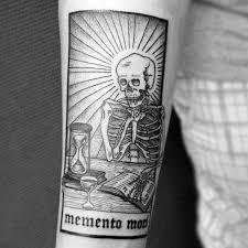 skeleton looking at hourglass mens memento mori inner forearm