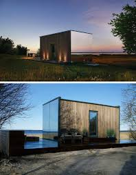 the modular ööd prefab house features mirrored glass and can be