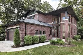 luxury brick home in suburbs with glass front door stock photo