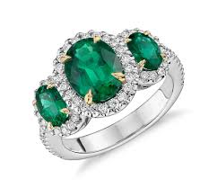 emerald three stone emerald and diamond halo ring in 18k white and yellow