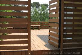 modern ironwood ipe wood deck with gate and benches a deck