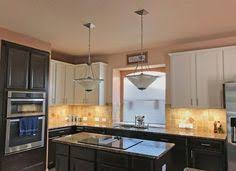 2700 kelvin led under cabinet lighting white cabinets pops of color with the mixing bowls and warm under