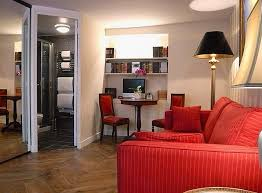 traditional studio apartment decorating with red sofa and chair