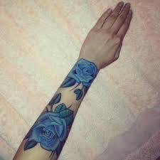 blue bird tattoo on wrist