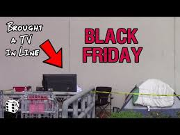 frys deals black friday black friday shopper brought large tv to watch while waiting in