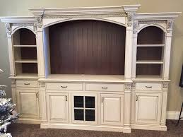 home theater columns antiqued white entertainment center with bead brown backs fluted