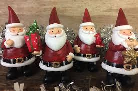 ornaments set of 4 individual santa figurines