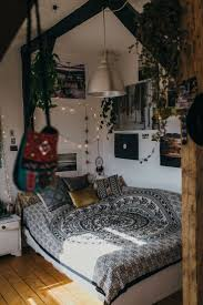 boho bedroom with hanging plants and mixed textiles interiors