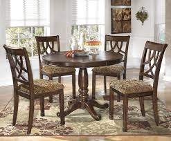 Cherry Wood Dining Room Furniture Leahlyn 5 Piece Cherry Finish Round Dining Table Set By Signature
