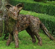 sculpture fox scrap wood and bark animal