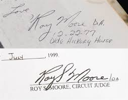 roy says signature is a forgery experts say more evidence