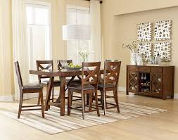 standard furniture omaha brown trestle dining room table with two