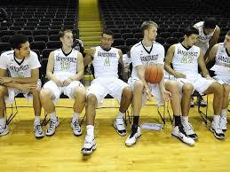 basketball player on bench vanderbilt men s basketball team media day