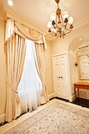 formal window coverings hung under the crown molding interior