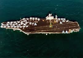over 1 000 sailors form a christmas tree on the flight deck of the