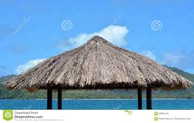 water bungalow straw roof tropical island background stock photo