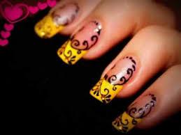 yellow nails with metallic tip design nail art