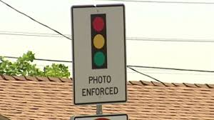 red light ticket video red light cameras are ticket fines voluntary abc news