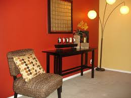 adorable red painted wall accents with black wooden console table