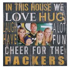 green bay packers in this house frame at the packers pro shop