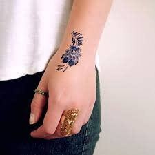 tattoo for hand 31 small hand tattoos that will make you want one styleoholic