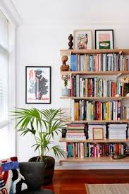 Green Bookshelves - our brooklyn apartment apartments cups and shelves