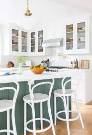 modern country white and grey green kitchen white bistro stools