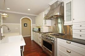kitchen with stainless steel backsplash traditional kitchen with flat panel cabinets simple marble