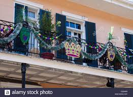 new orleans wrought iron balcony decorated for mardi gras with