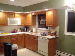cream kitchen cabinets with grey walls kitchen decoration