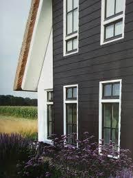 dark outside with black windows add white trim house ideas