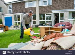 a man works clearing the damage done to his home aberystwyth uk by