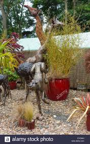 a collection of garden ornaments large size steel animals giraffes