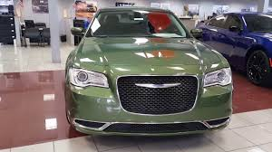 chrysler 300 2018 2018 chrysler 300 in green metallic and 2018 charger sxt in